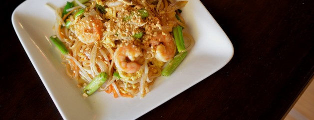 Pad Thai – Rice noodle, egg, carrot, bell pepper, mushroom, scallion, onion, and bean sprout served with cilantro, lime, and crushed peanuts